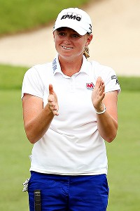 Stacy Lewis overcame two bogeys and some shaky putting on the back nine to hold on for a 1-stroke victory at the HSBC Women's Champions.