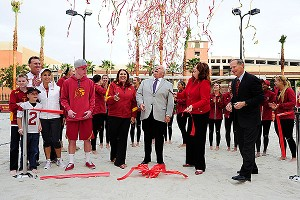 Streamers filled the air as AD Pat Haden and sand volleyball coach, Anna Collier, conclude the ribbon-cutting ceremony to officially open the USC Merle Norman Stadium.