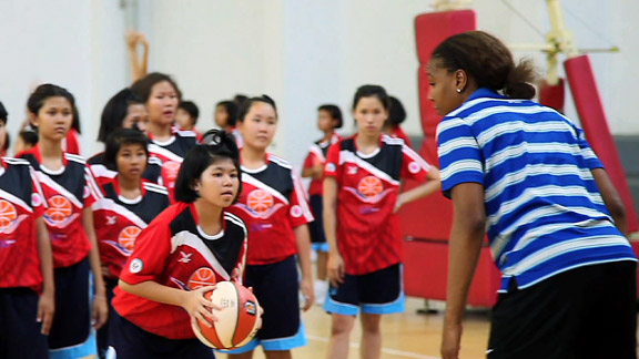 Practice makes perfect. Tamika Catchings (pictured here), along with Ebony Hoffman and Becky Bonner, lead clinics in Bangkok, where they met with more than 100 young female athletes between the ages of 12-15.