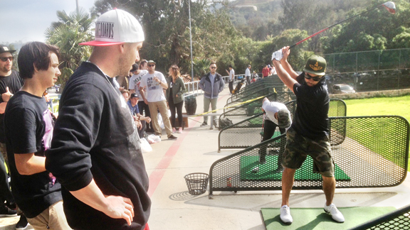 Sean Malto and Brandon Biebel watch Koston's form during tee-off.