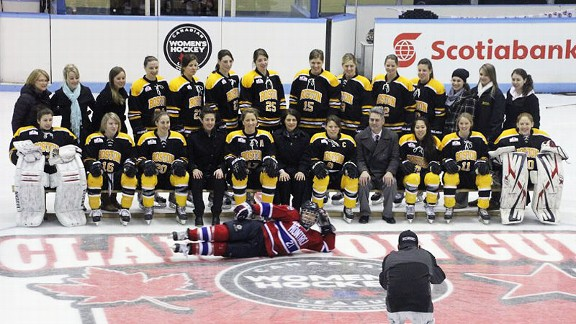 Julie Chu, who plays for the Montreal Stars, jokingly drops in on the Boston Blades' team photo at the Clarkson Cup. Montreal lost to Boston 5-2 in the finals on March 23.