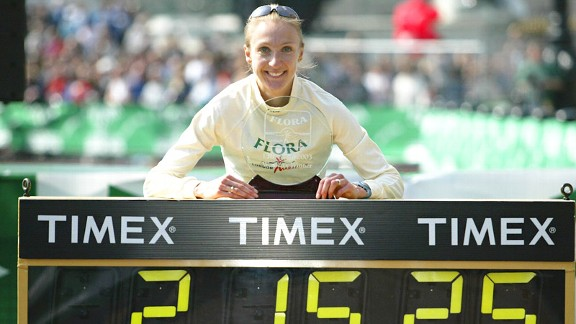 Paula Radcliffe poses with her world-record time after her run in the London Marathon on April 13, 2003.