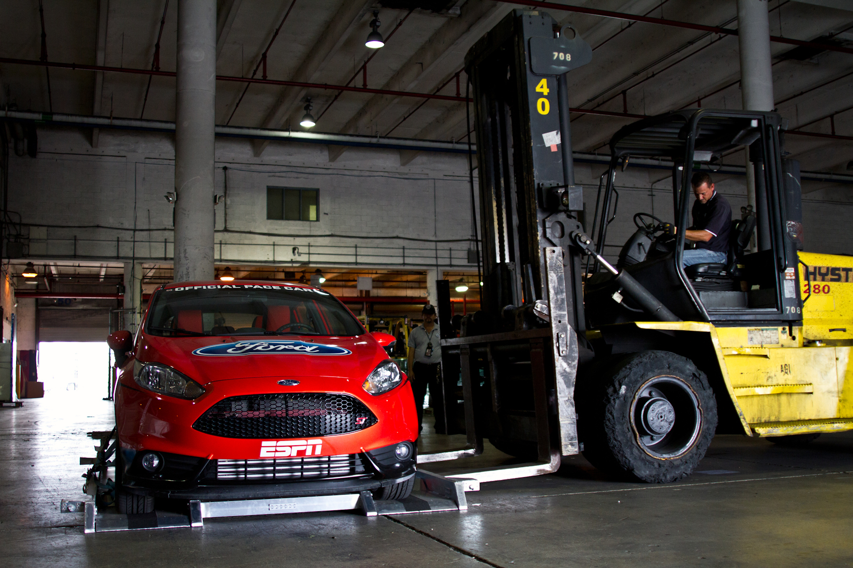 The official X Games RallyCross pace car, a Ford Fiesta, is about to get a lift during the final loading process in Miami.