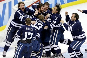 Yale won its first NCAA hockey championship with a 4-0 victory over top-seeded Quinnipiac on Saturday night.