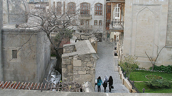 Baku's Old Town is ancient but is still a residence for many in Azerbaijan's largest city. It is a contrast of old and new, restored and crumbling. There are many details that are striking -- like elaborate doors that lead to green courtyards.