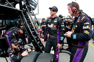 Denny Hamlin stands in his pit box after being replaced in his car by Brian Vickers during the Sprint Cup race at Talladega.