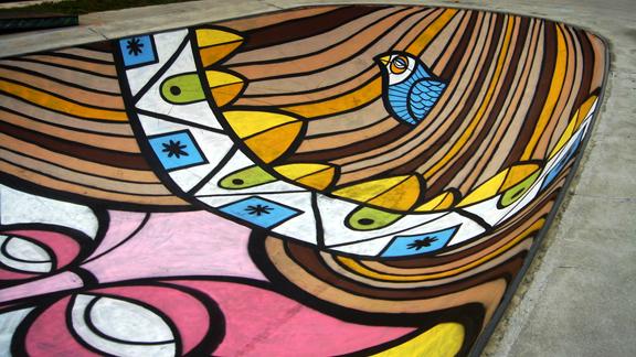 Barcelona artist Ruben Sanchez's art graces the inside of a bowl at a city skatepark.