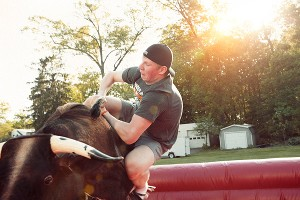 Steve Saunders threw the Russians a party Friday as a going-away present. He rented a mechanical bull, which Nikita Cherepanov fails to master.