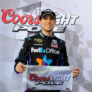 Denny Hamlin won the pole for Sunday's Coca-Cola 600 at Charlotte Motor Speedway with a record lap of 195.624 mph.