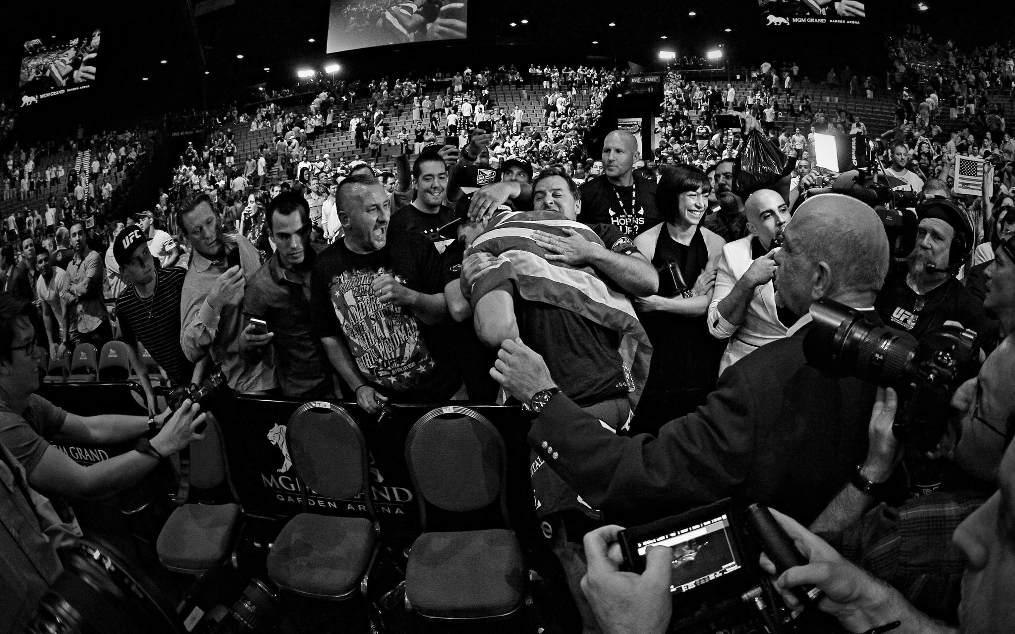 Chris Weidman hugs Anderson Silva