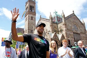 Jason Collins (left) marched in Boston's gay pride parade Saturday.
