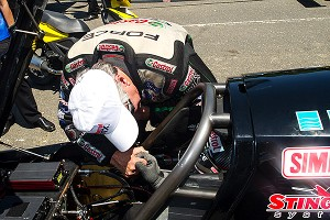 Whenever his daughters race, John Force stands behind their car at the starting line.