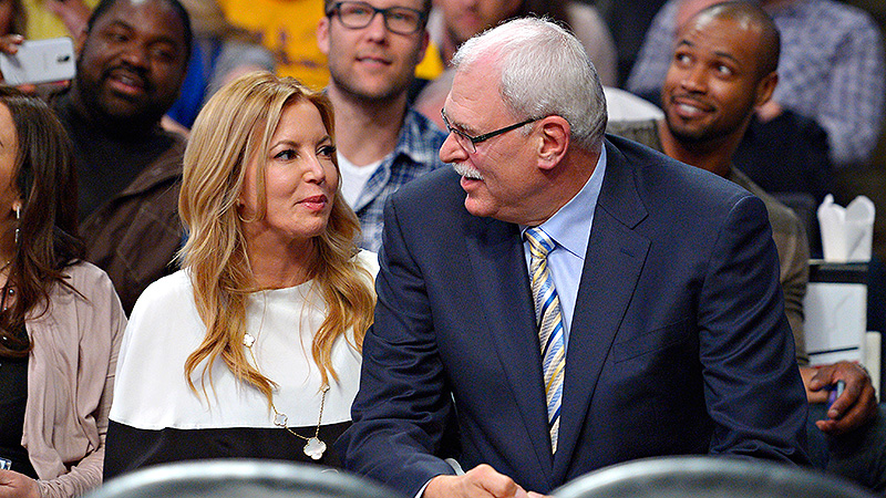 Legendary basketball coach Phil Jackson started dating Jeanie Buss, the Lakers' executive vice president of business operations and daughter of the team's owner, in 1999 when he was coaching the team. After two stints coaching the Lakers and five championship rings, Jackson retired in 2011. However, after his successor was fired, Jackson and the Lakers conversed about a potential return. The team ultimately went with Mike D'Antoni. Despite the potential awkwardness at family gatherings, Jackson and Buss announced their engagement over the holidays. (Photo: Mark J. Terril/AP)