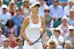 Maria Sharapova had trouble keeping her shots inbounds and herself upright in a 6-3, 6-4 upset to Portugal's Michelle Larcher de Brito.