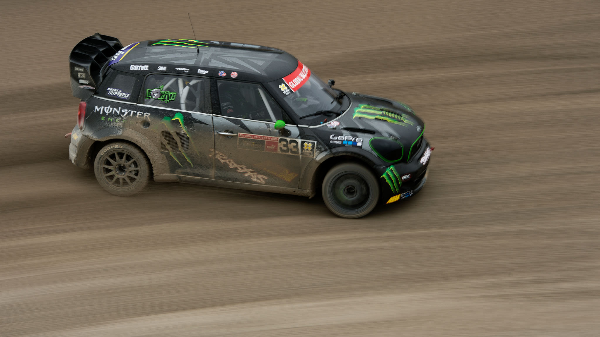 Liam Doran races his Mini to victory Saturday at X Games Munich despite puncturing a tire in the fourth lap. Lets say the wet conditions and the track design was working in favor for my car, Doran said.
