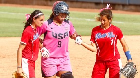 Two Puerto Rico players help American Amber Freeman round the bases after she injured her ankle on her home run trot in the semifinal game. I thanked them multiple times, Freeman said. It shows people the sportsmanship we have in this sport.