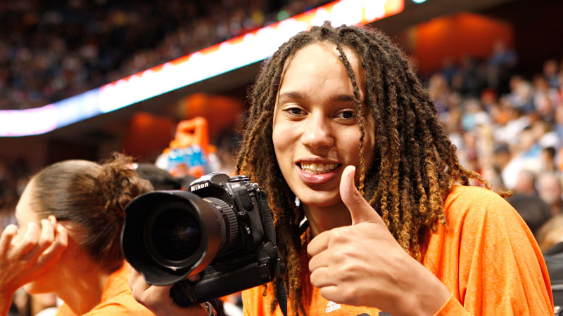 Brittney Griner takes photos from the All-Star bench. She couldn't play because of a sparined knee.