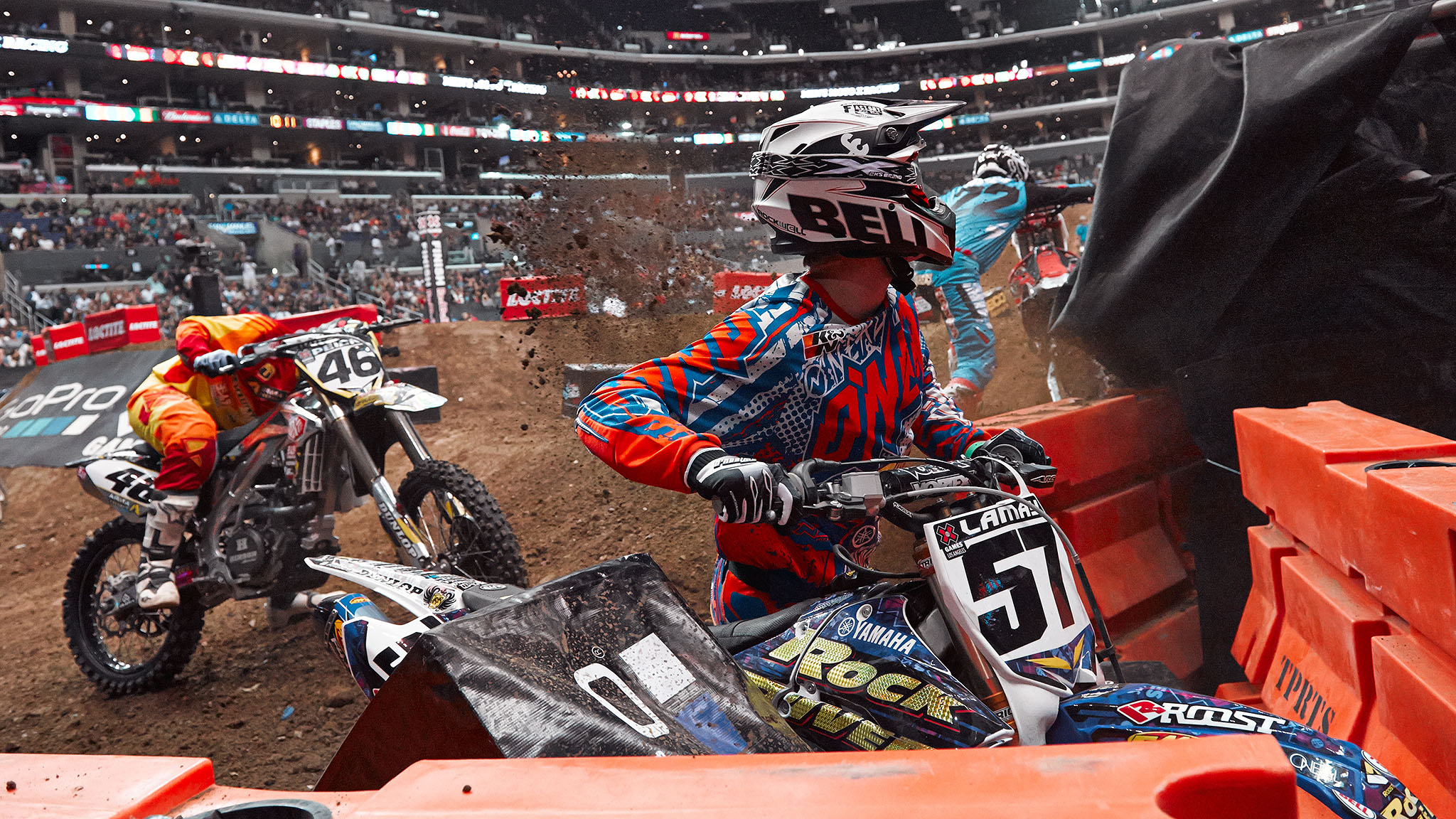 Chad Reed squeezed Ben LaMay and Weston Peick out on the hole shot in the Men's Moto X Racing final Saturday night, sending the two into the jersey barrier on the first turn of the first lap. LaMay got back into the race, but Peick had to roll his bike off the track.