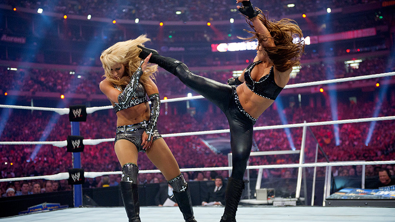 Seven-time WWE women's champion Trish Stratus, right, couldn't find any relief from the pain caused by years of wrestling until she discovered yoga.