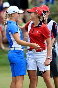 Charley Hull, at 17 the youngest player in Solheim history, scored a resounding  5 and 4 victory over Paula Creamer -- and then asked for her autograph.