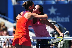 Flavia Pennetta, left, gets congratulations from 10th-seeded Roberta Vinci after a 6-4, 6-1 quarterfinal victory.