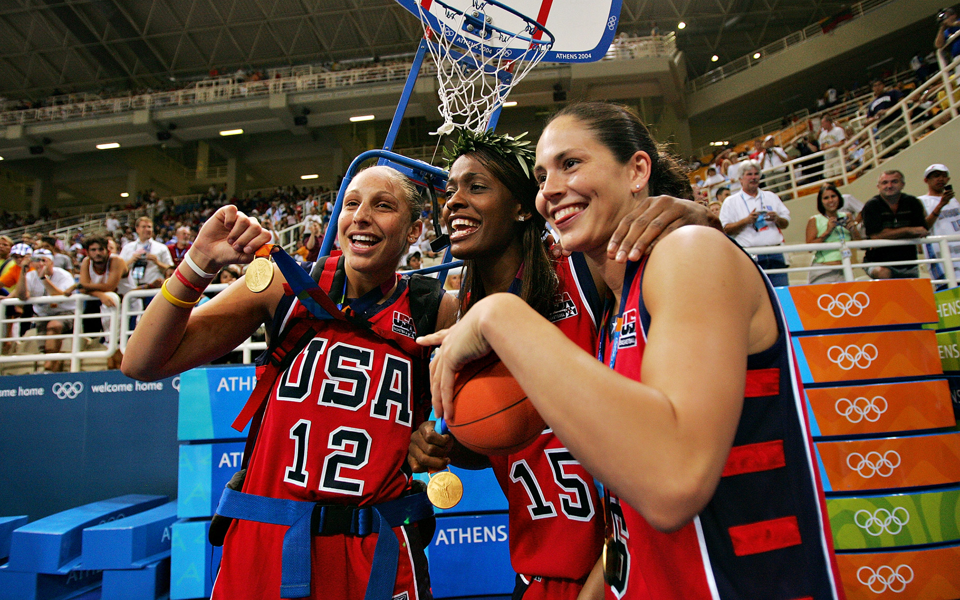 Diana Taurasi, left, won the first of her three Olympic gold medals in Athens in 2004. Here, she's celebrating with Swin Cash, center, and Sue Bird.
