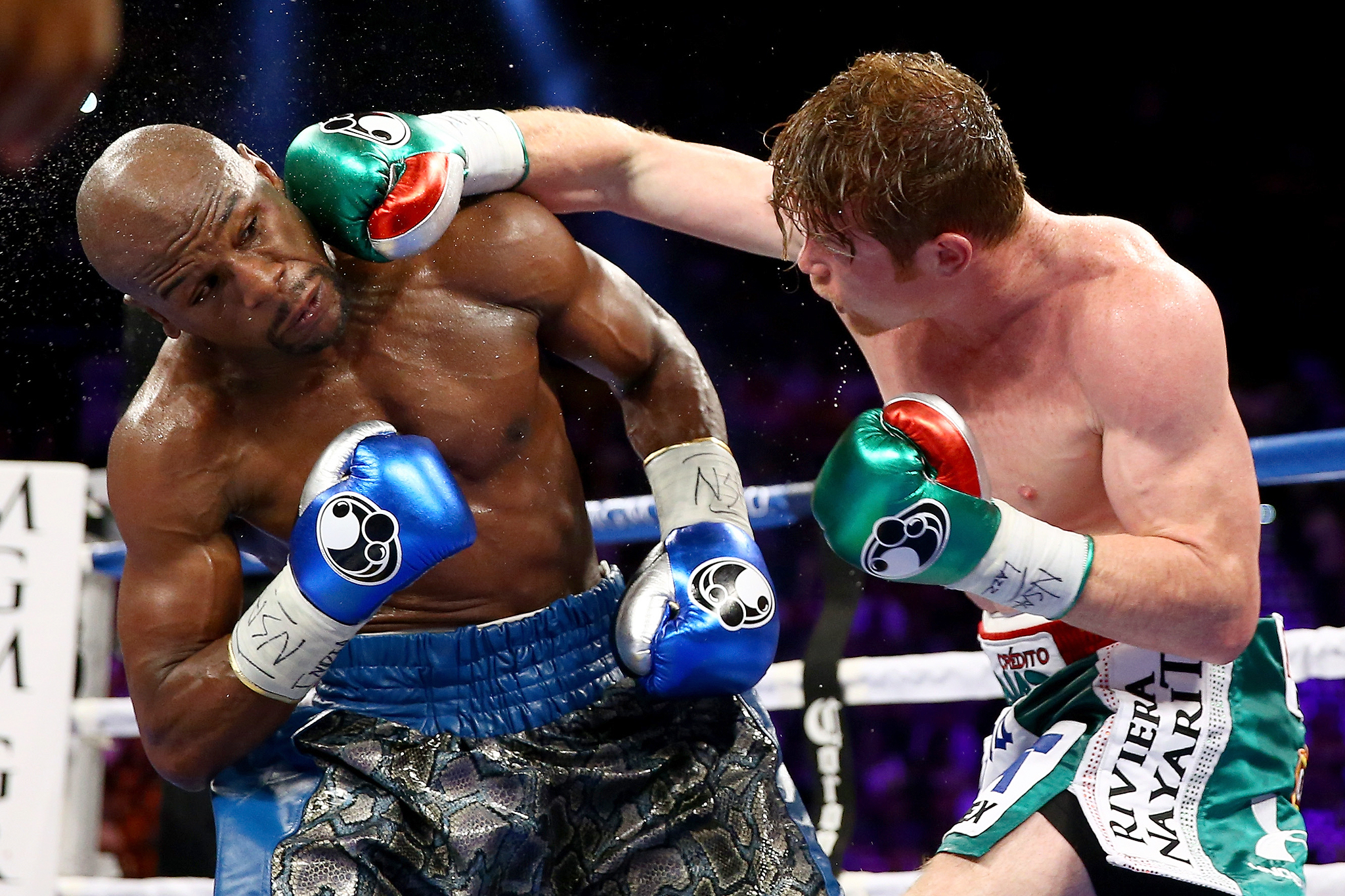 Canelo Alvarez connects with Floyd Mayweather Jr.