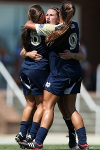 Freshman star Morgan Andrews (center) celebrates her goal against North Carolina with teammates Cari Roccaro (left) and Lauren Bohaboy.