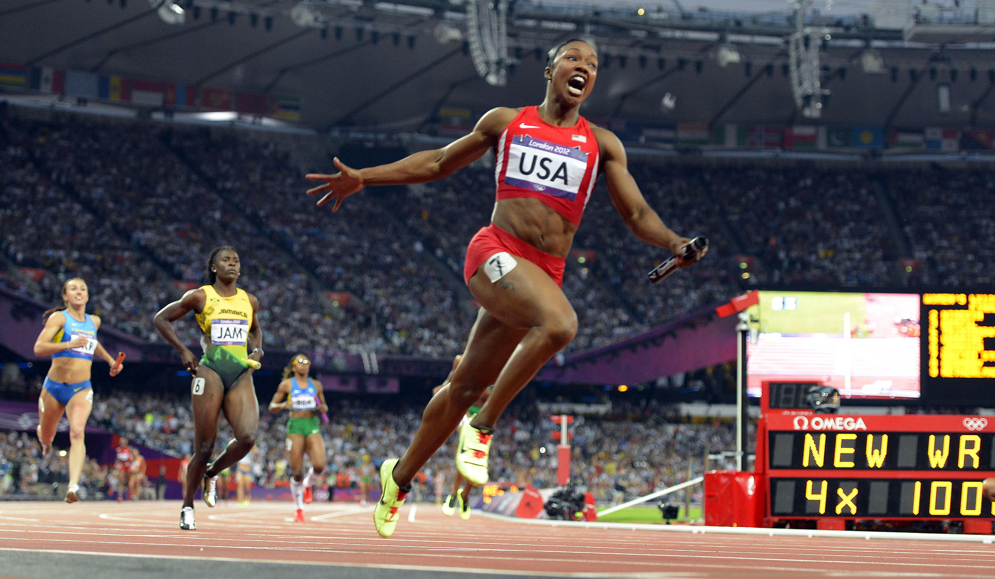Carmelita Jeter celebrates after crossing the finish line in a world-record time in the 4x100 relay at the London Olympics. The U.S. team finished in 40.82, more than a half-second better than a record that had stood for 27 years.