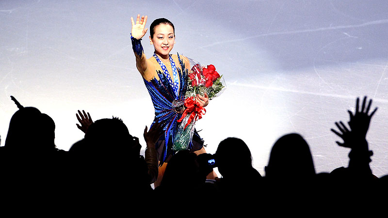 Japan's Mao Asada waves to the crowd after capturing the gold medal at Skate America on Sunday.
