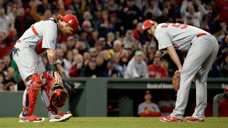 Catcher Yadier Molina, left, and pitcher Adam Wainwright let a popup fall between them, part of a laughable night for the Cardinals in Game 1 of the World Series.