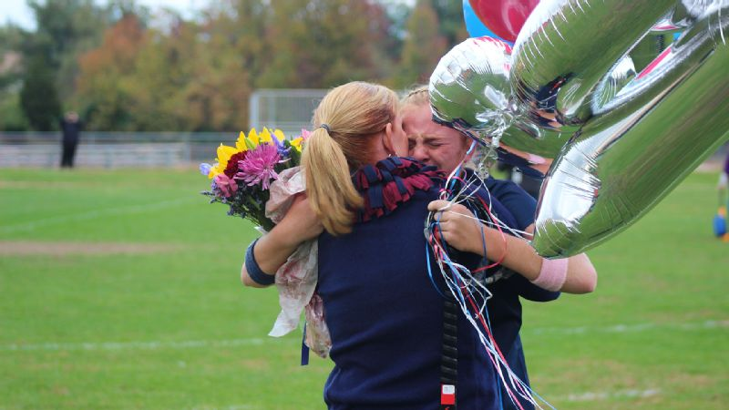 Austyn Cuneo hugs her mom, who reluctantly took a job as a middle-school field hockey coach years ago. The rest is history.