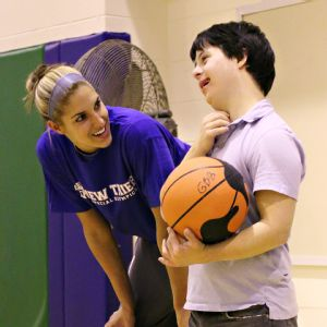 Delle Donne has a smile with a Special Olympian after a pick-up game.