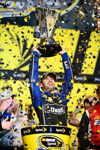 Jimmie Johnson hoists the Sprint Cup championship trophy at Homestead-Miami Speedway.