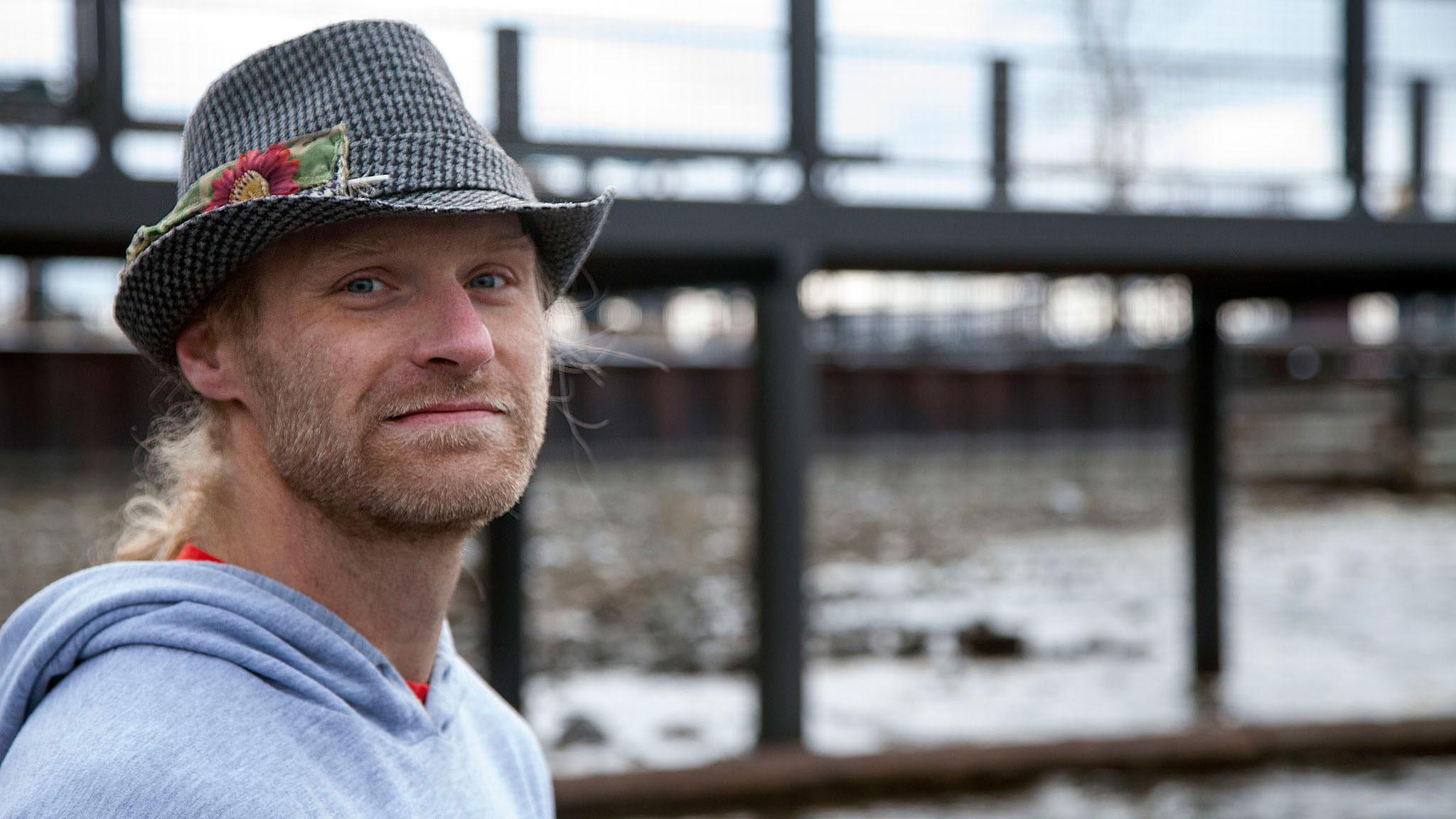 Kevin O'Meara wearing Kip Garre's fedora hat on the shores of Lake Tahoe.