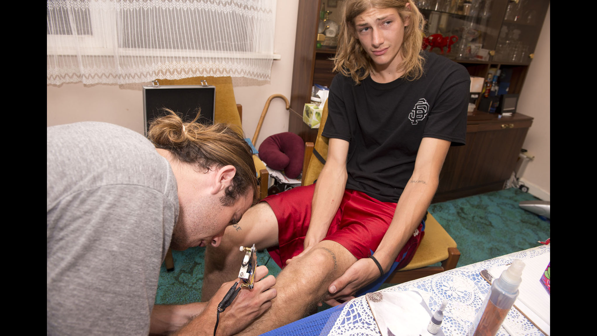 Zero flow team rider Ed Duff getting a tattoo of the name Dane Burman by Zero pro Dane Burman.