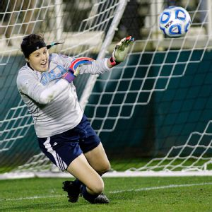 UCLA goaltender Katelyn Rowland makes one of her two saves on Virginia penalty kicks during Friday's semifinal.