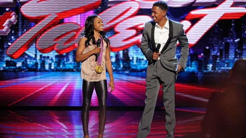 pFresh off her gold-medal win in the All Around competition at the London Olympics, newly anointed Americas sweetheart was a natural choice to help Nick Cannon host a results episode of Americas Got Talent. Decked out with her two gold medals around her neck, Douglas' presence alone prompted more enthusiasm from the crowd than any of the featured contestants. While she didn't have much of the show's heavy-lifting, Douglas did a fine job talking about her Olympic experience and reading from the prompter. /ppGrade: Solid B. She's no Mario Lopez but significantly better than Khloe Kardashian's ill-fated X Factor attempt. (Photo: Virginia Sherwood/NBC/NBCU Photo Bank/Getty Images)/p
