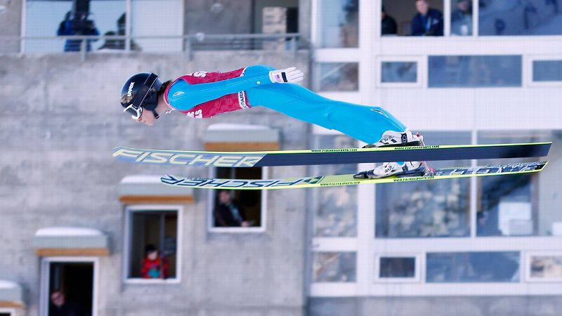 Jessica Jerome soared into history by winning the U.S. Olympic ski jumping trials Sunday.