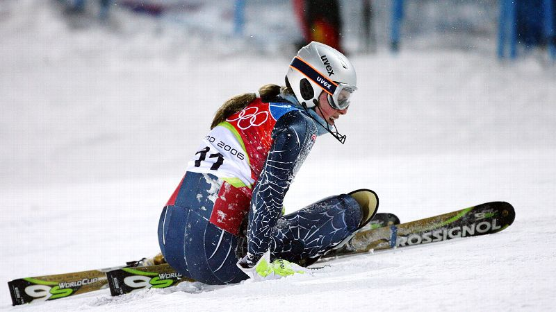 Making her second Olympics appearance, Vonn, still known as Kildow, failed to medal in any of her three events in Italy but did win the U.S. Olympic Spirit Award. After a scary crash during a practice run for the downhill, Vonn was airlifted to a local hospital. Despite minor injuries, she competed two days later and finished in eighth place, impressing fans and fellow competitors. (Photo: Olivier Morin/AFP/Getty Images)