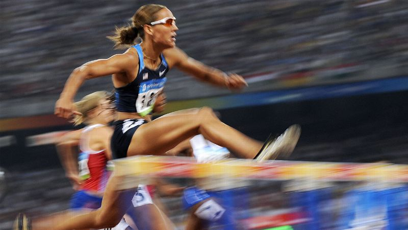 The favorite to strike gold in the 100-meter hurdles at the 2008 Olympics in Beijing, Jones cruised through the qualifying events and looked poised for Olympic glory. (Photo: Fabrice Coffrini/AFP/Getty Images)