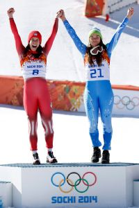Dominique Gisin, Tina Maze celebrate on the podium after winning the women's downhill for the first gold-medal tie in Olympic Alpine skiing history.