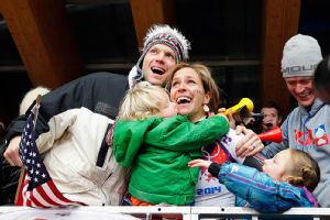 Noelle Pikus-Pace found her family in the stands after she realized she clinched a silver medal at the Sochi Games.