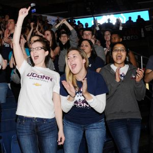UConn fans cheer on the Huskies during a broadcast at Gampel Pavilion as the women's team routed Notre Dame 79-58 to capture their record ninth national title.