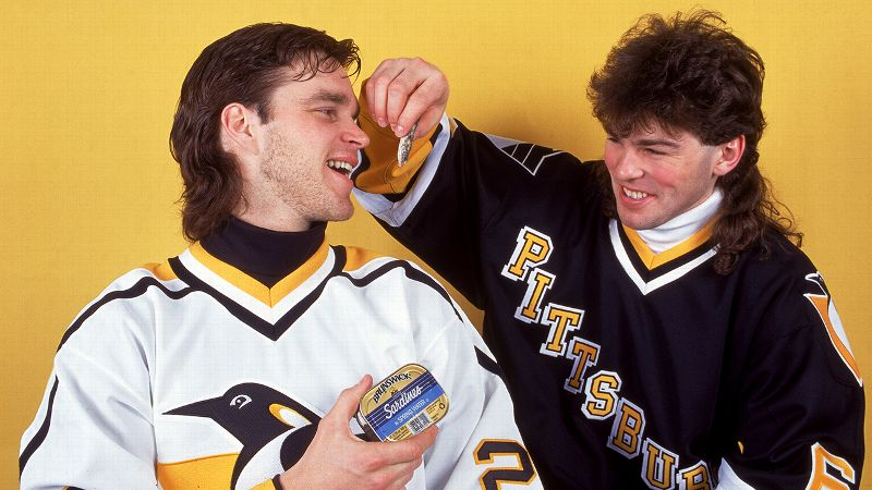 Yes, this is a picture of a mullet-donning Jagr feeding sardines to his former Penguins teammate Luc Robitaille. You're welcome.