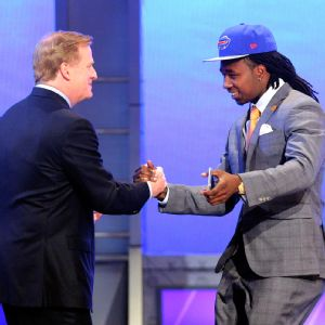 Watkins goes in for the hug with Roger Goodell after being selected by the Bills.