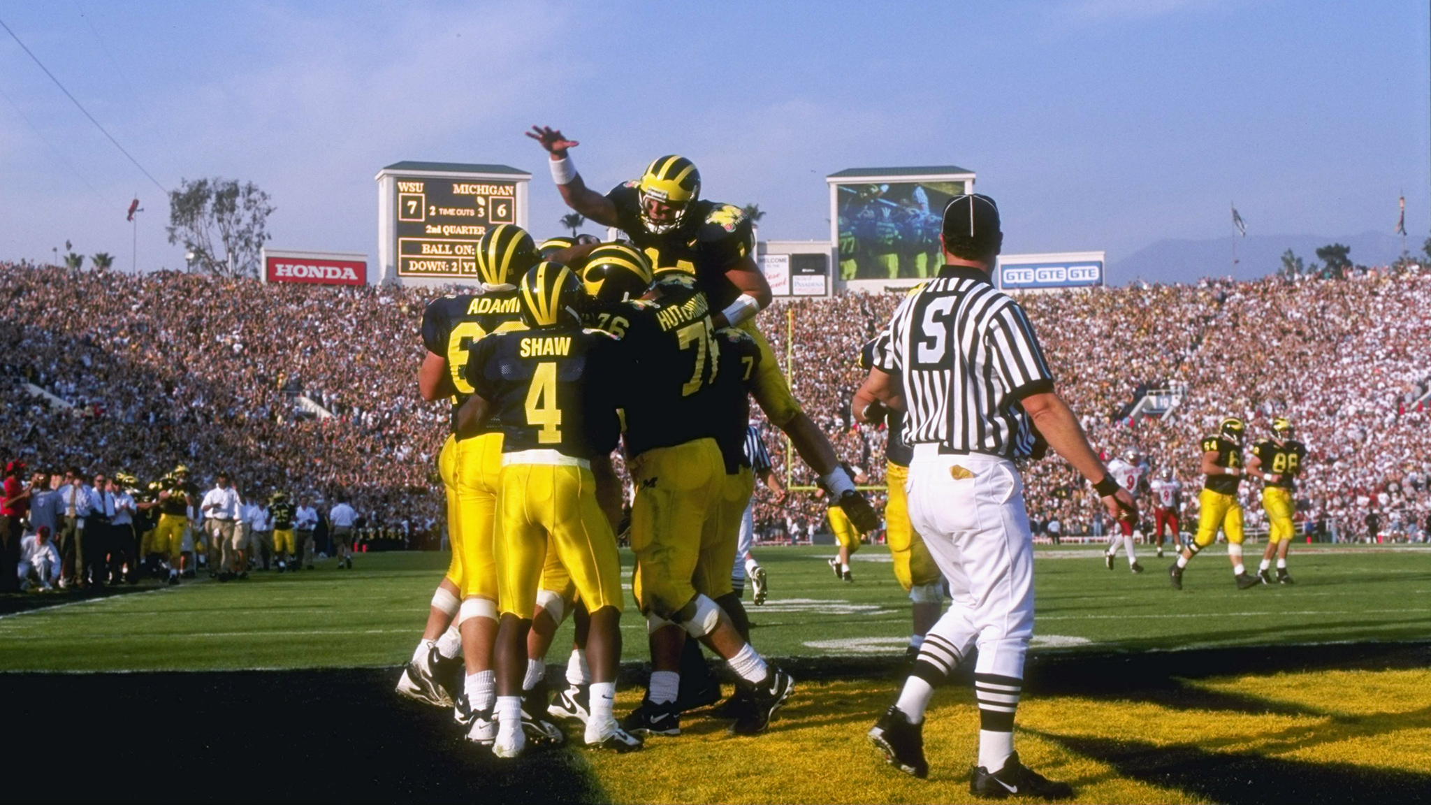 Quarterback and MVP Brian Griese celebrates with the Michigan Wolverines after they won the 1998 Rose Bowl and a share of the 1997 NCAA national championship. Brian's father, NFL Hall of Famer Bob Griese, commentated the game on national television.