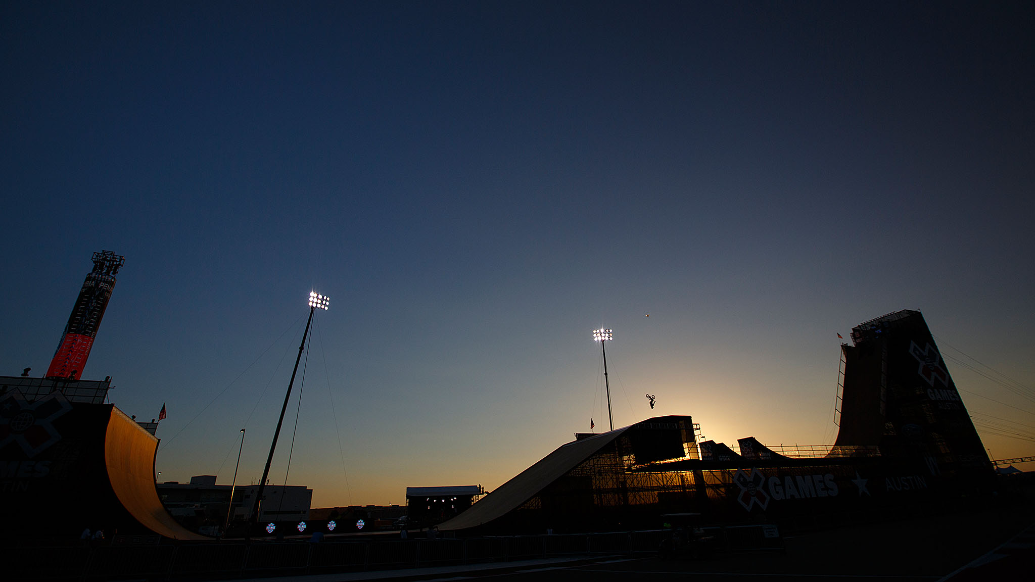 2014 marked the first time since the introduction of the MegaRamp to X Games that it had been constructed in Texas. Here, an unknown BMX Big Air competitor gets in some twilight practice before the start of X Games Austin 2014.