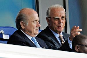 Former FIFA executive committee member Franz Beckenbauer, right, initially failed to cooperate with an investigation into Qatar's 2022 World Cup bid.
