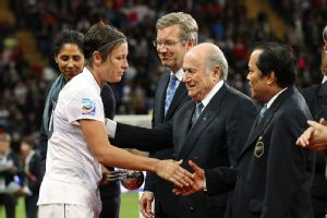 Abby Wambach and Joseph S. Blatter